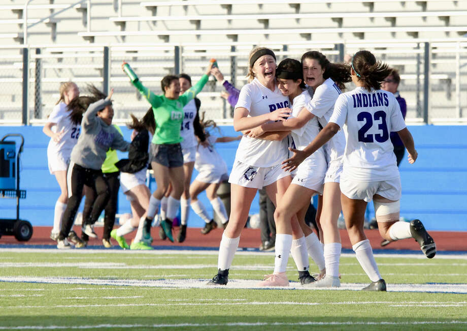 Port Neches-Groves' Breeana Riggs, left, reacts with her teammates after Riggs scored with 11 seconds left in the second half against Richmond Foster in Tuesday's Class 5A Area Round playoff game at Barbers Hill High School in Mont Belvieu. The score broke a 0-0 tie, giving PN-G a 1-0 win to advance to the Class 5A Regionals. Photo: Mike Tobias /NDN Press