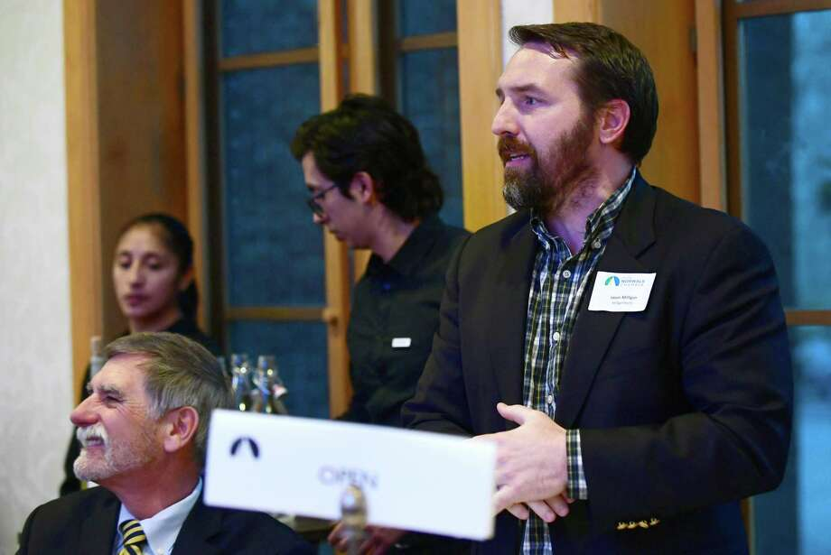 Jason Milligan asks a question of the governor at The Greater Norwalk Chamber of Commerce 130th Annual Dinner Tuesday April 2, 2019, at Lakota Oaks in Norwalk, Conn. Milligan filed a lawsuit against the property owner for Wall Street Place Development, stating that he has easements on the property. Photo: Erik Trautmann / Hearst Connecticut Media / Connecticut Post