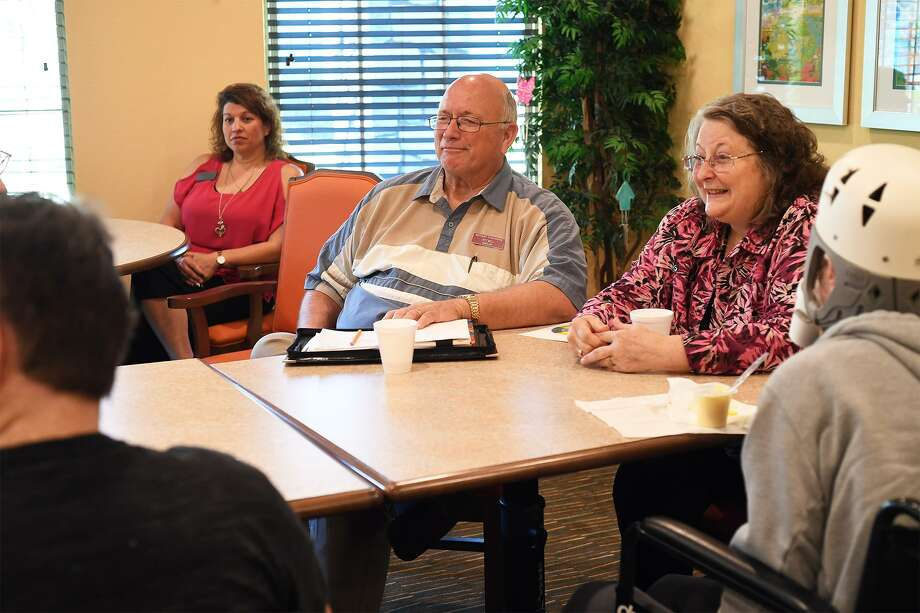 Background from left, Stephanie Roberts, Jeff Bell and Patricia Coppage lead a grief counseling group at the Bonne Vie nursing facility on Tuesday. The event is a partnership between Hospice and Claybar Funeral Home.  Photo taken Tuesday, 3/26/19 Photo: Guiseppe Barranco/The Enterprise / Guiseppe Barranco / The Enterprise / Guiseppe Barranco ©