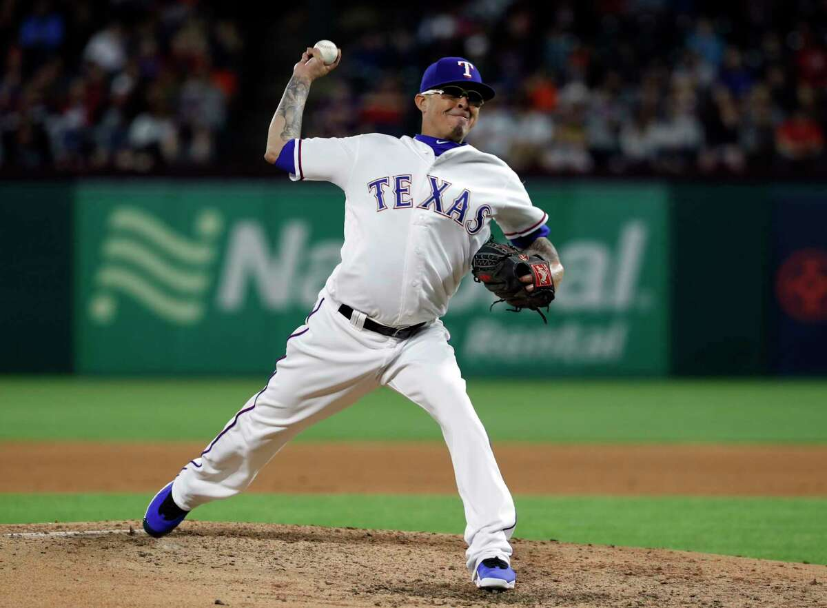 Texas Rangers relief pitcher Jesse Chavez (53) throws to the Houston Astros in the fourth inning of a baseball game in Arlington, Texas, Tuesday, April 2, 2019. (AP Photo/Tony Gutierrez)