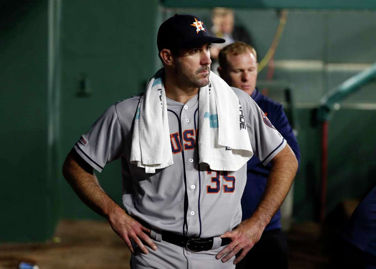 Houston Astros starting pitcher Justin Verlander (35) walks through the dugout after being pulled in the fifth inning of a baseball game against the Texas Rangers in Arlington, Texas, Tuesday, April 2, 2019. (AP Photo/Tony Gutierrez)