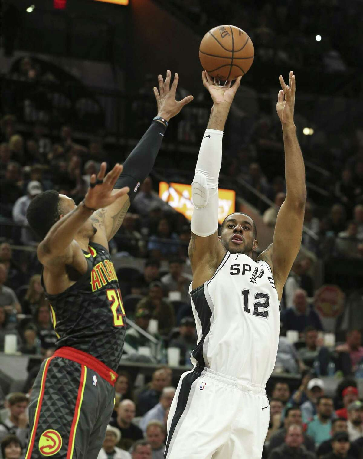 Spurs' LaMarcus Aldridge (12) fades back for a jumper against Atlanta Hawks' Kent Bazemore (24) during their game at the AT&T Center on Tuesday, Apr. 2, 2019. (Kin Man Hui/San Antonio Express-News)