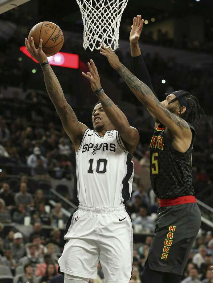 Spurs' DeMar DeRozan (10) attempts a score against Atlanta Hawks' DeAndre' Bembry (95) during their game at the AT&T Center on Tuesday, Apr. 2, 2019. (Kin Man Hui/San Antonio Express-News) Photo: Kin Man Hui, Staff / Staff Photographer / ©2019 San Antonio Express-News
