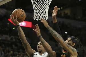 Spurs' DeMar DeRozan (10) attempts a score against Atlanta Hawks' DeAndre' Bembry (95) during their game at the AT&T Center on Tuesday, Apr. 2, 2019. (Kin Man Hui/San Antonio Express-News)