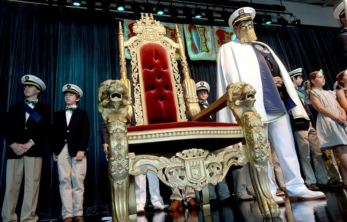 The still anonymous king joins the attendants and past kings onstage during the official unveiling of the Neches River Festival's King Neches LXXI Tuesday at the Event Centre. Photo taken Tuesday, April 2, 2019 Kim Brent/The Enterprise
