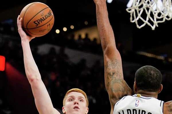 Atlanta Hawks' Kevin Huerter (3) shoots against San Antonio Spurs' LaMarcus Aldridge during the first half of an NBA basketball game, Tuesday, April 2, 2019, in San Antonio. (AP Photo/Darren Abate)