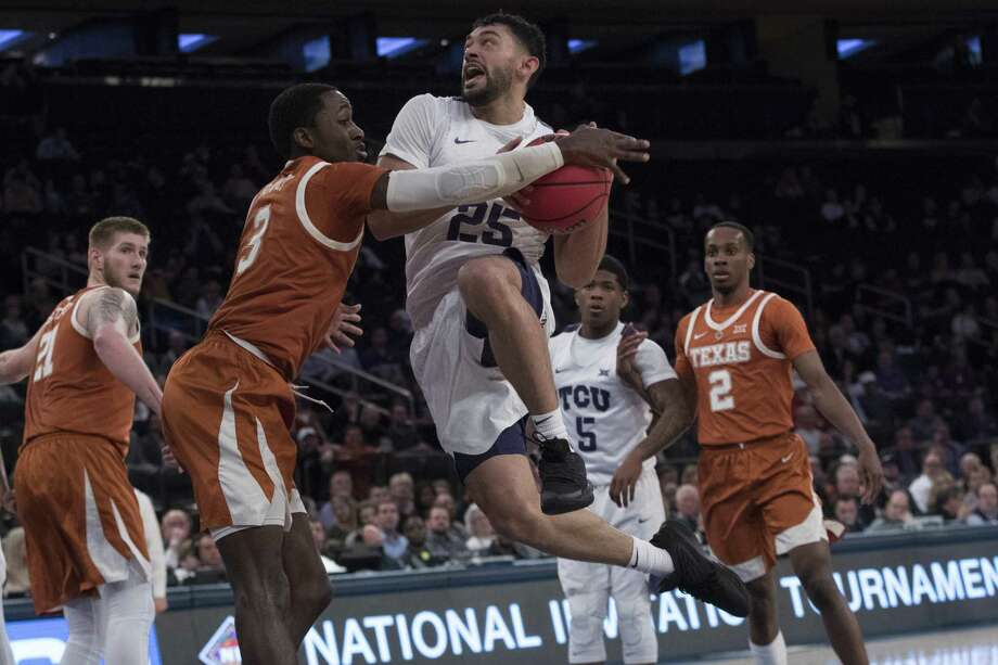 TCU guard Alex Robinson goes airborne on his drive only to encounter UT guard Courtney Ramey at Madison Square Garden. Photo: Mary Altaffer / Associated Press / Copyright 2019 The Associated Press. All rights reserved.