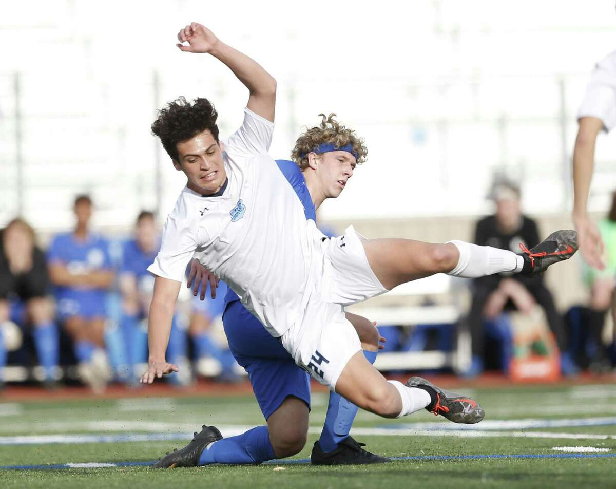 Johnston Alexis Rosas upended by a New Braunfels player. Johnston v New Braunfels in boys 6A second round boys soccer at Comalander Stadium on Monday April 2 , 2019.