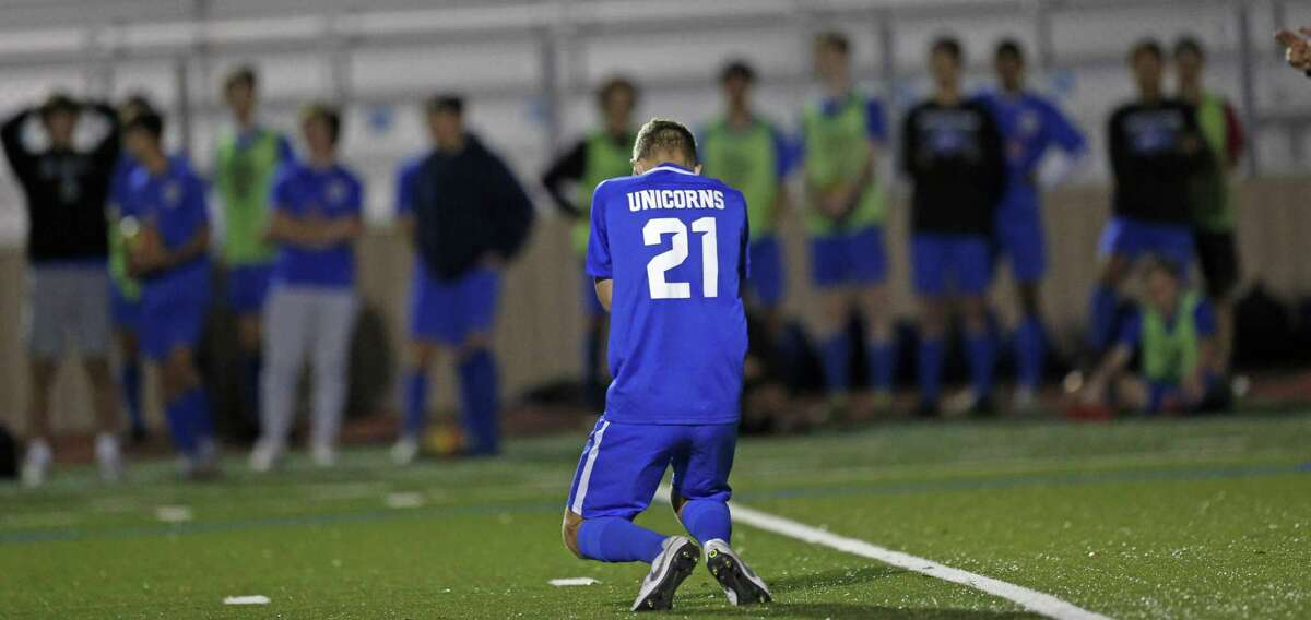 New Braunfels's Rhett Fischer falls to the ground after missing on the last shot in penalty kicks. Johnston v New Braunfels in boys 6A second round boys soccer at Comalander Stadium on Monday April 2 , 2019.