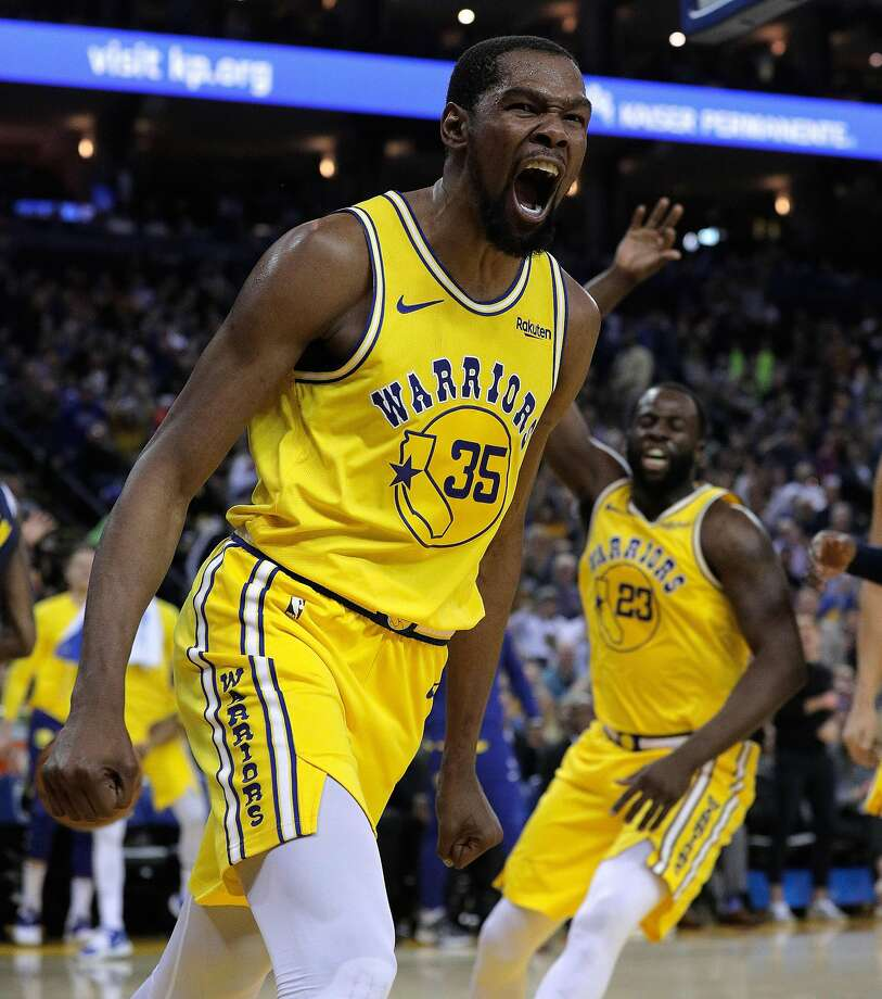 Kevin Durant (35) reacts after dunking late In the first half as the Golden State Warriors played the Denver Nuggets at Oracle Arena in Oakland, Calif., on Tuesday, April 2, 2019. Photo: Carlos Avila Gonzalez / The Chronicle