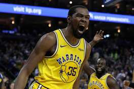 Kevin Durant (35) reacts after dunking late In the first half as the Golden State Warriors played the Denver Nuggets at Oracle Arena in Oakland, Calif., on Tuesday, April 2, 2019.