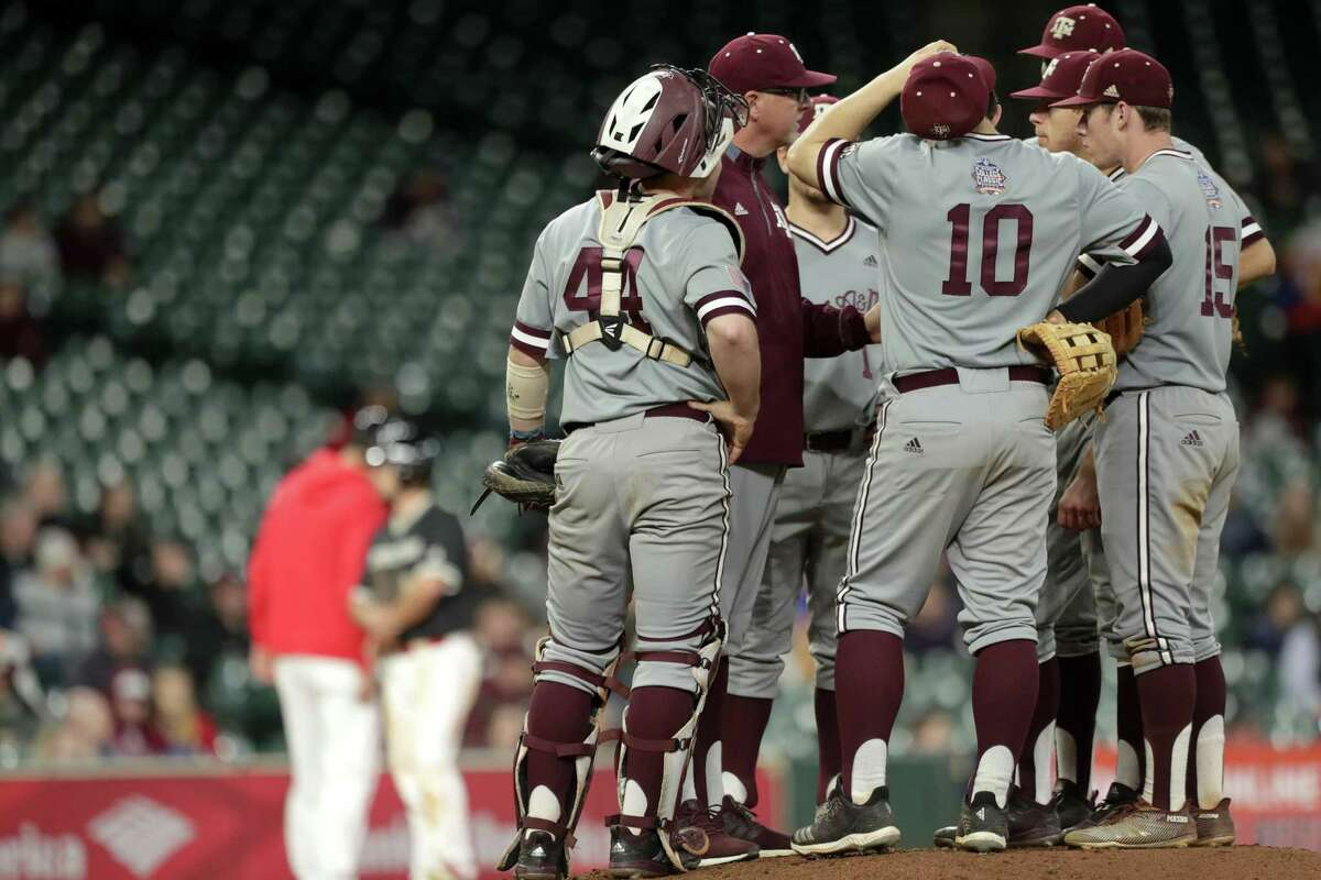 Texas Aggies head coach Rob Childress talks with Texas Aggies Chandler Jozwiak (18) during the fourth inning of a game in the 2019 Shriners College Classic at Minute Maid Park, Sunday, March 3, 2019, in Houston.