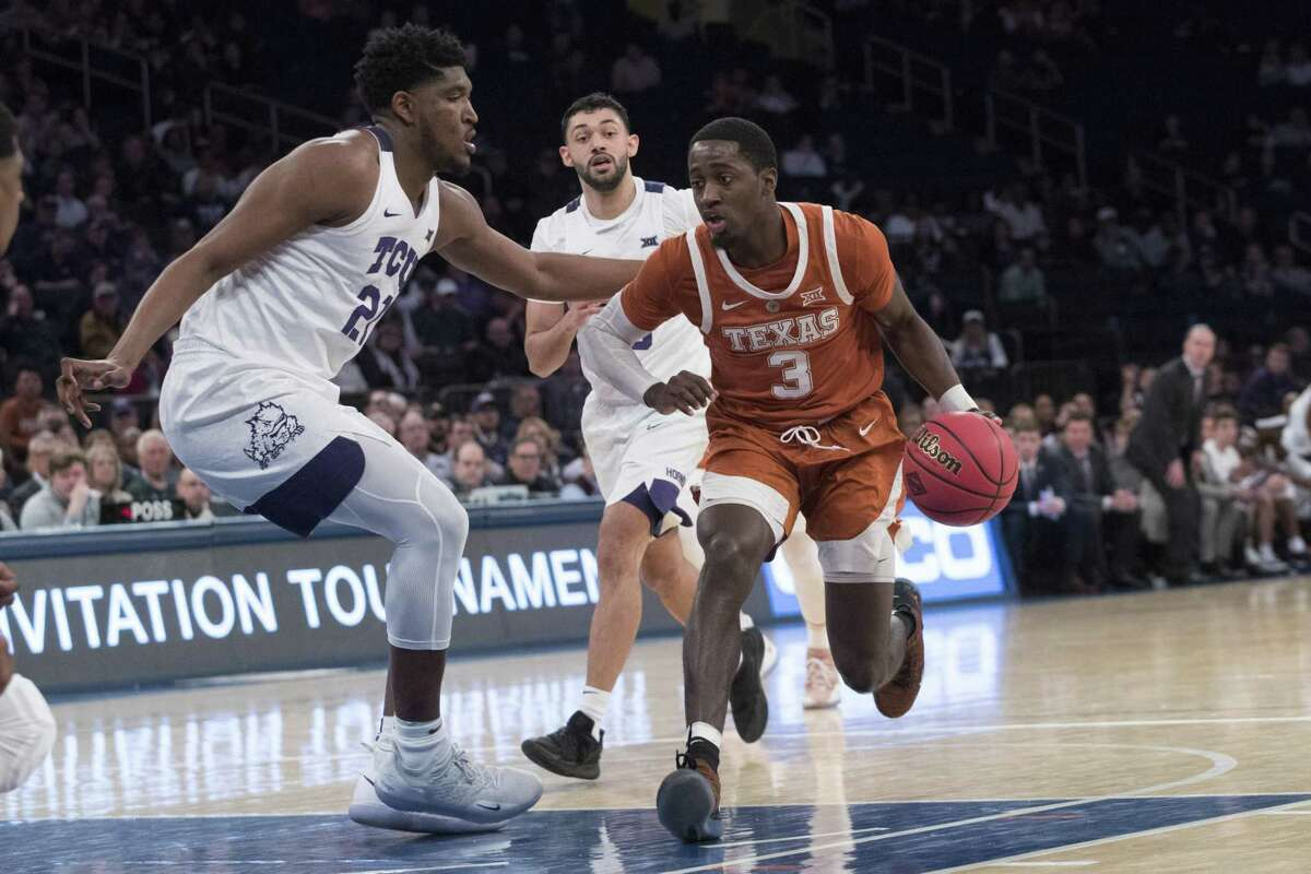 Texas guard Courtney Ramey, right, is not afraid to go inside and challenge TCU center Kevin Samuel at Madison Square Garden.