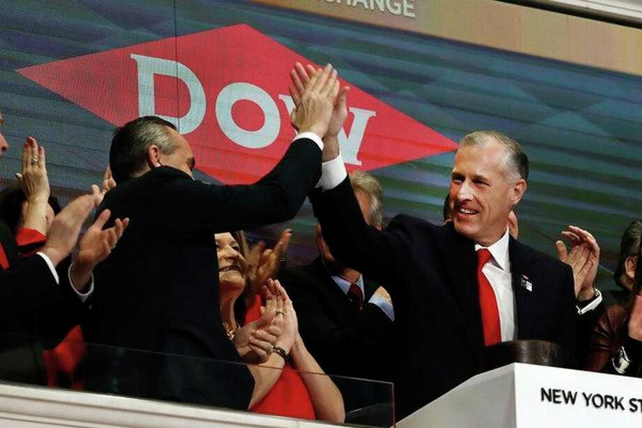 Dow CFO & President Howard Ungerleider, left, and CEO Jim Fitterling high five during opening bell ceremonies of the New York Stock Exchange on Tuesday, April 2, 2019. This week, Dow officially became one of three spinoff companies from the former DowDuPont. (AP Photo/Richard Drew) / Copyright 2019 The Associated Press. All rights reserved.
