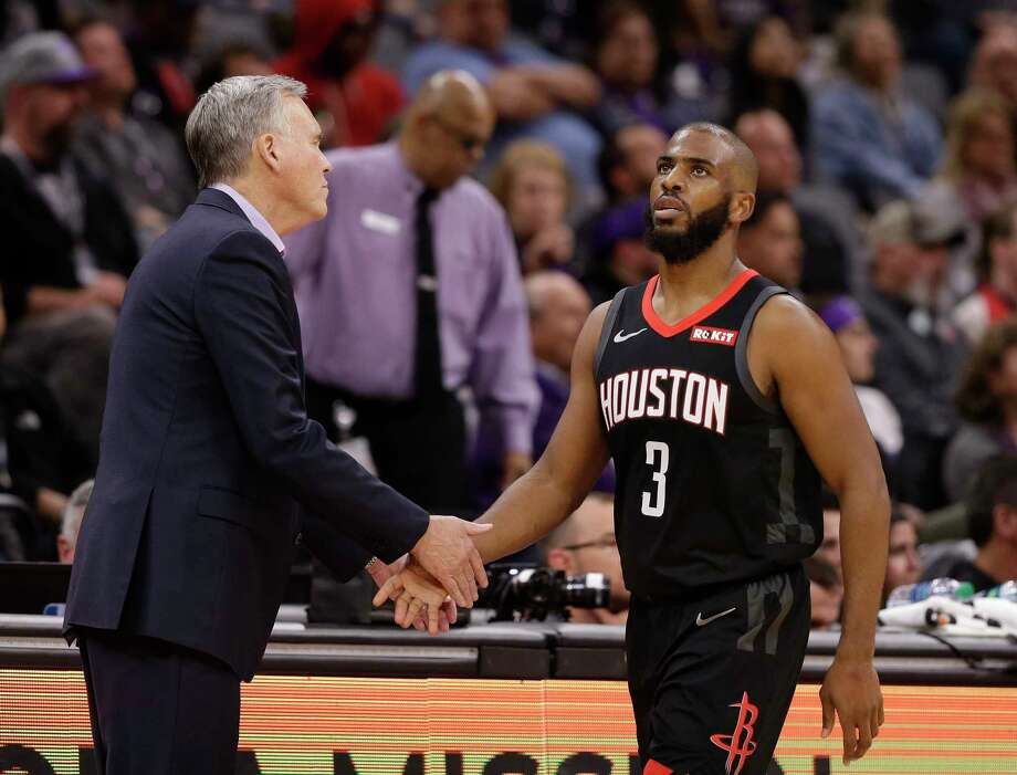 Houston Rockets head coach Mike D'Antoni, left, shakes hands with guard Chris Paul as he leaves the game in the final moments of the Rockets' 130-105 win over the Sacramento Kings in an NBA basketball game, Tuesday, April 2, 2019, in Sacramento, Calif. (AP Photo/Rich Pedroncelli) Photo: Rich Pedroncelli, Associated Press / Copyright 2019 The Associated Press. All rights reserved.