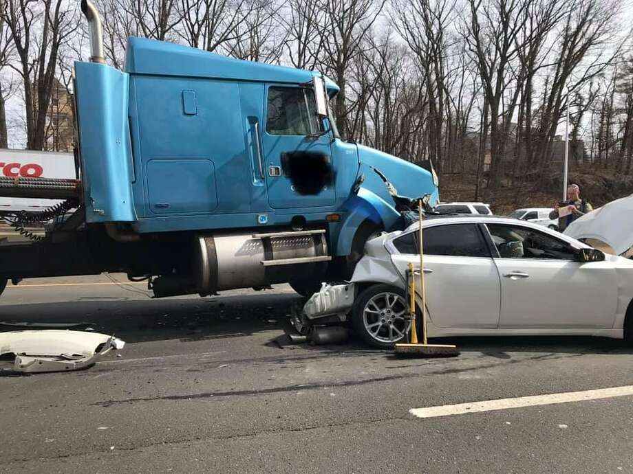 "Amazingly, the driver of this vehicle was not injured in a crash involving two tractor-trailer trucks on I-95 in Greenwich on Tuesday. April 2, 2019. Despite the extensive rear and front-end damage, Greenwich firefighters said ""the driver of the car was able to self extricate from the passenger side. There were no reported injuries."" Photo: Greenwich Professional Firefighters Photo"