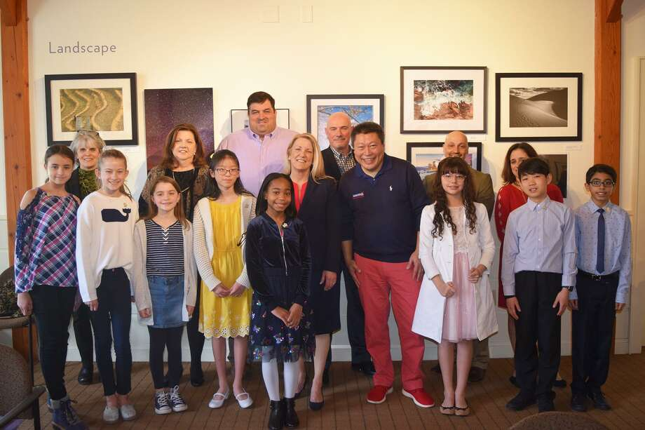 State Rep. Brenda Kupchick and State Sen. Tony Hwang, center, with the essay contest winners. Photo: Contributed Photo