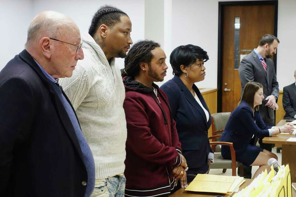 Attorney Michael Feit, left, his client, Mario Gorostiza, second from left, Armando Sanchez, third from left, and his attorney, Sherri Brooks, appear in Albany City Court on Wednesday, April 3, 2019, in Albany, N.Y. (Paul Buckowski/Times Union)