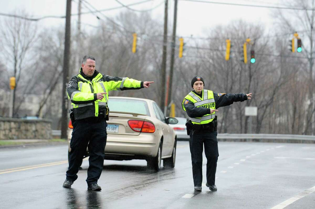 Stamford police officers flag down distracted drivers on Courtland Avenue as part of the