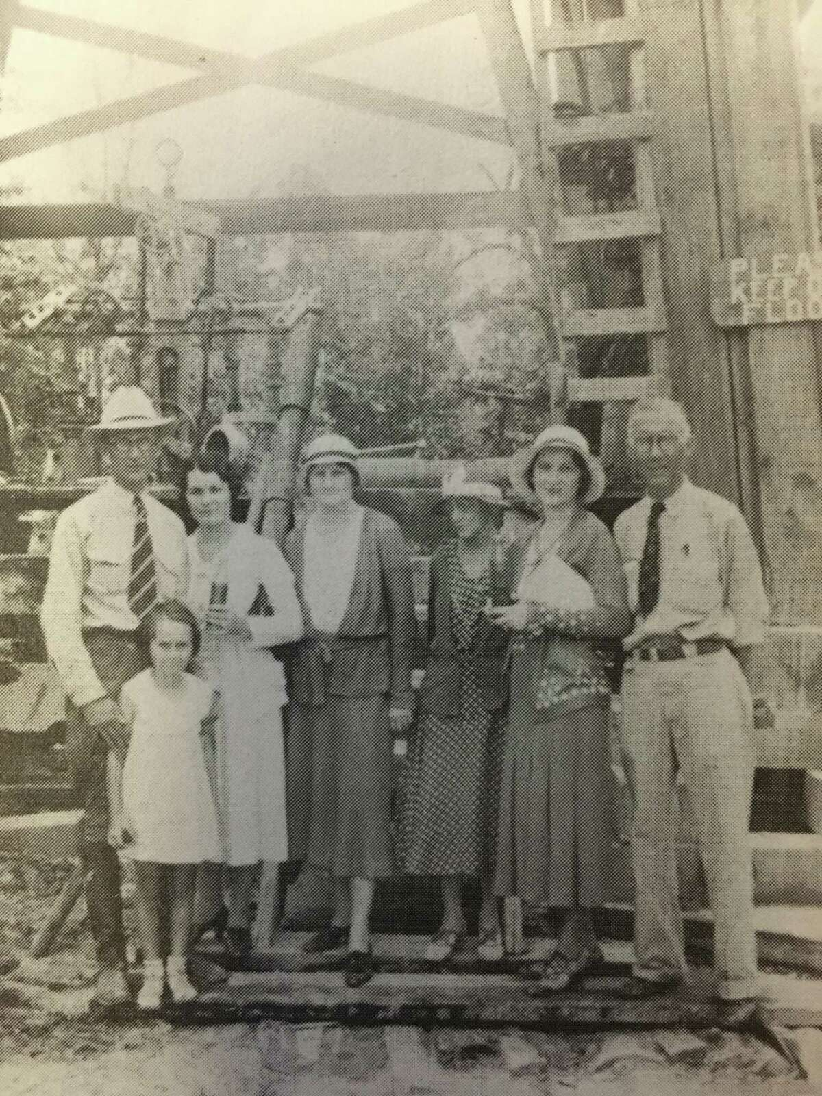 George Strake and his wife, Susan, with their daughter, Betty, and Mr. and Mrs. Bill Pfiffner in front of Strake's first oil well.