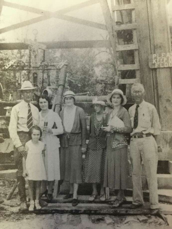 "George Strake and his wife, Susan, with their daughter, Betty, and Mr. and Mrs. Bill Pfiffner in front of Strake's first oil well. Photo: From Sally Murphy Evans' ""Conroe, Texas: A Quincentennial Project."""