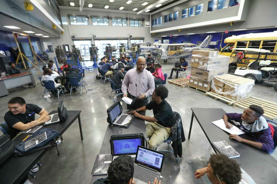 Sterling High School Career & Technology Education Department Chair, John Chilo leads a class in a large hanger / classroom Monday, Feb. 12, 2018, in Houston. ( Steve Gonzales / Houston Chronicle ) Photo: Steve Gonzales, Staff Photographer / Houston Chronicle / © 2018 Houston Chronicle