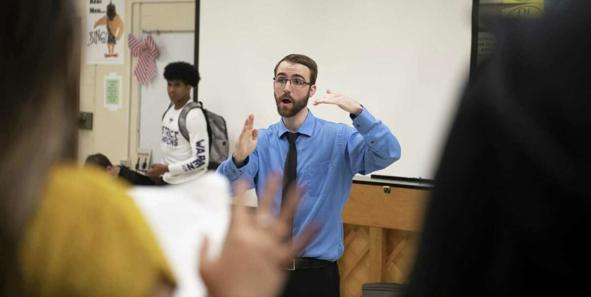 Earl Warren High School Choir teacher Colin Varville conducts his class during practice on Thursday, March 20, 2019. The choir has been invited to perform at Carnegie Hall in New York on April 28.