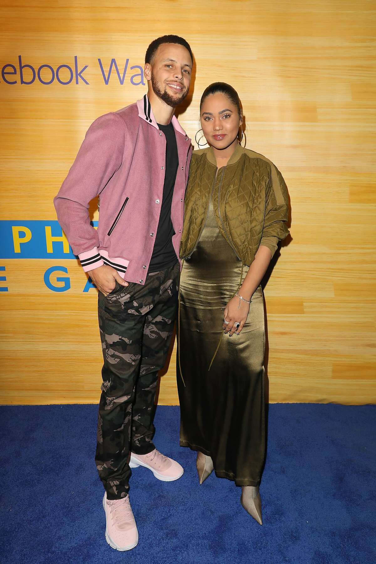 Stephen and Ayesha Curry pose for a photo on the red carpet at 16th Street Station on April 1, 2019 in Oakland, California.
