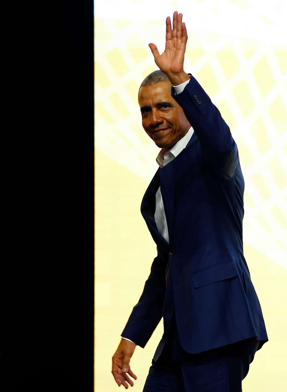 SEVILLE, SPAIN - APRIL 03: Former U.S. President Barack Obama waves during the World Travel and Tourism Council Global Summit on April 03, 2019 in Seville, Spain. Seville is hosting the 19th Summit of the World Travel & Tourism Council, which brings together the leaders of the global travel and tourism industry, from April 3-4. (Photo by Marcelo del Pozo/Getty Images)