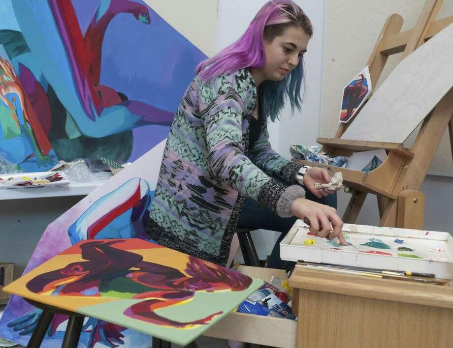 Danbury Painting senior Veronica Woods working on her series of dance-inspired figure paintings on custom-shaped wood panels. Photo: WCSU / Contributed Photo