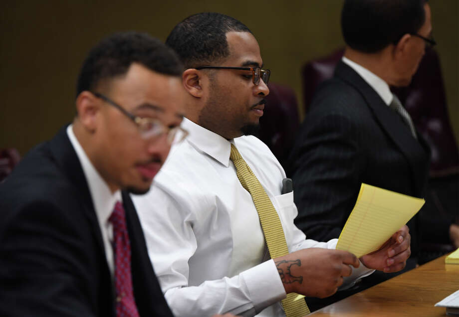Calvin Holman, center, during the first day of his capital murder trial. He is charged with fatally shooting Raymond Weatherly, 63, at his west Beaumont home in 2016. Holman is seated between his attorneys Sean Villery Samuel, left, and Audwin Samuel. Photo taken Wednesday, 4/3/19 Photo: Guiseppe Barranco/The Enterprise / Guiseppe Barranco ?