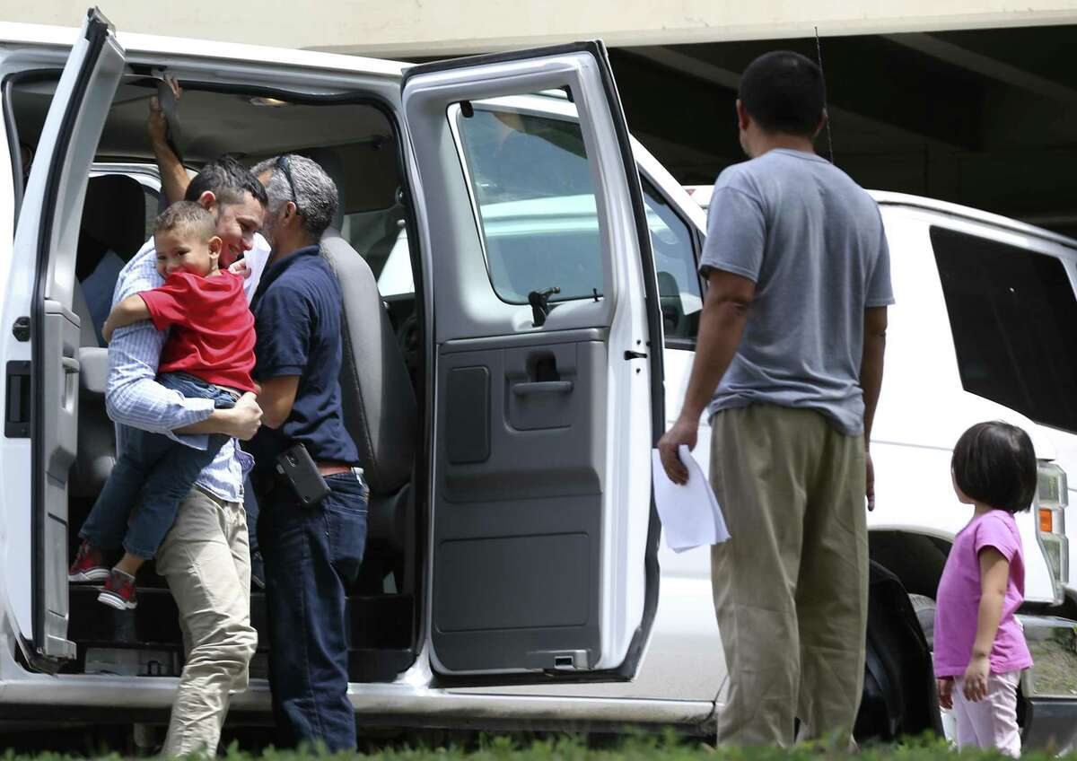 Immigrant families arrive at the Archdiocese of San Antonio Catholic Charities offices in San Antonio, Wednesday, July 11, 2018. Earlier the families left a U.S. Immigration and Customs Enforcement facility after they were reunited overnight.