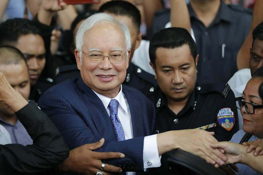 Former Prime Minister Najib Razak gets into a car after his court appearance at the Kuala Lumpur High Court. Photo: Vincent Thian / Associated Press
