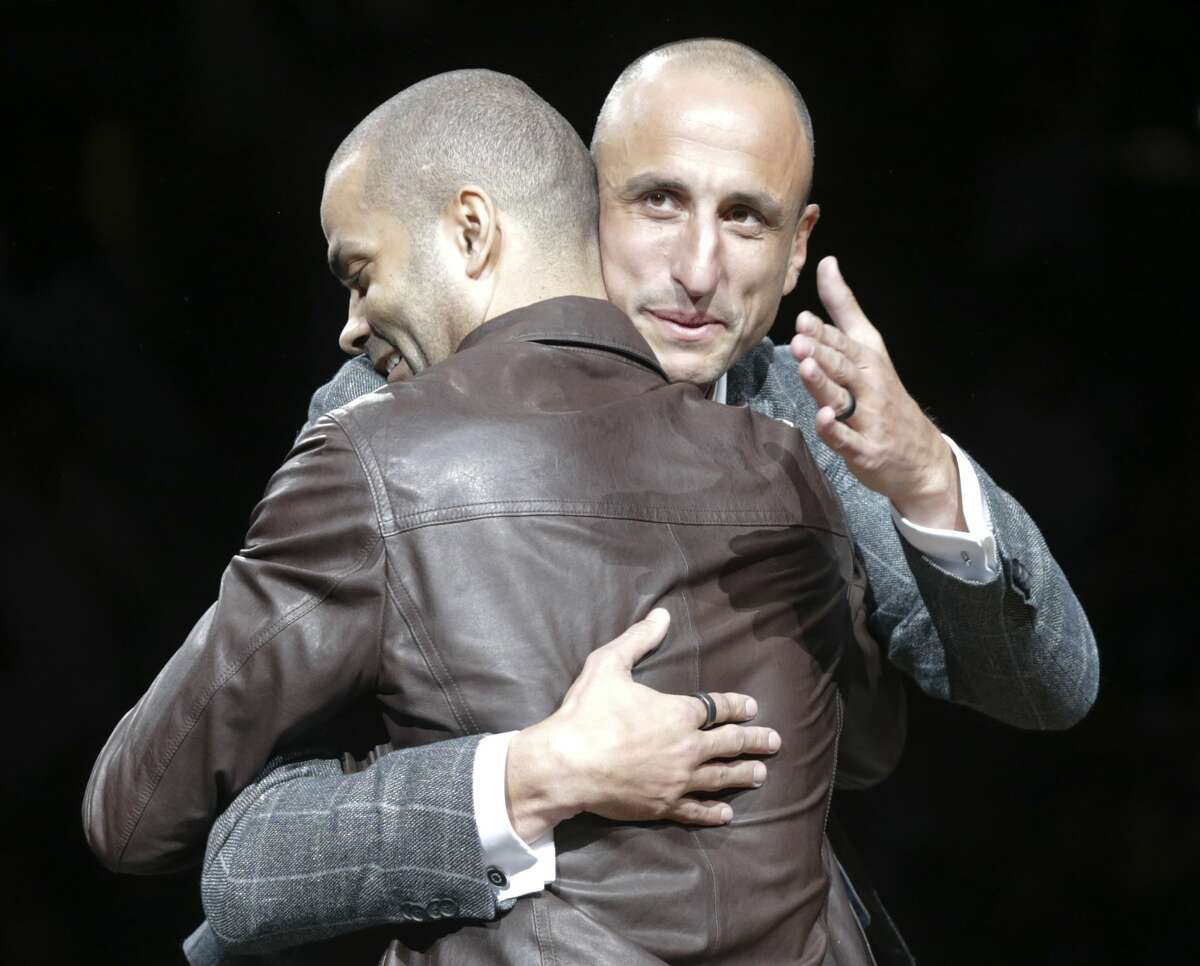 Tony Parker hugs the honoree as Manu Ginobili is celebrated at his retirement ceremony at the AT&T Center following the Spurs game against the Cleveland Cavaliers on March 28, 2019.