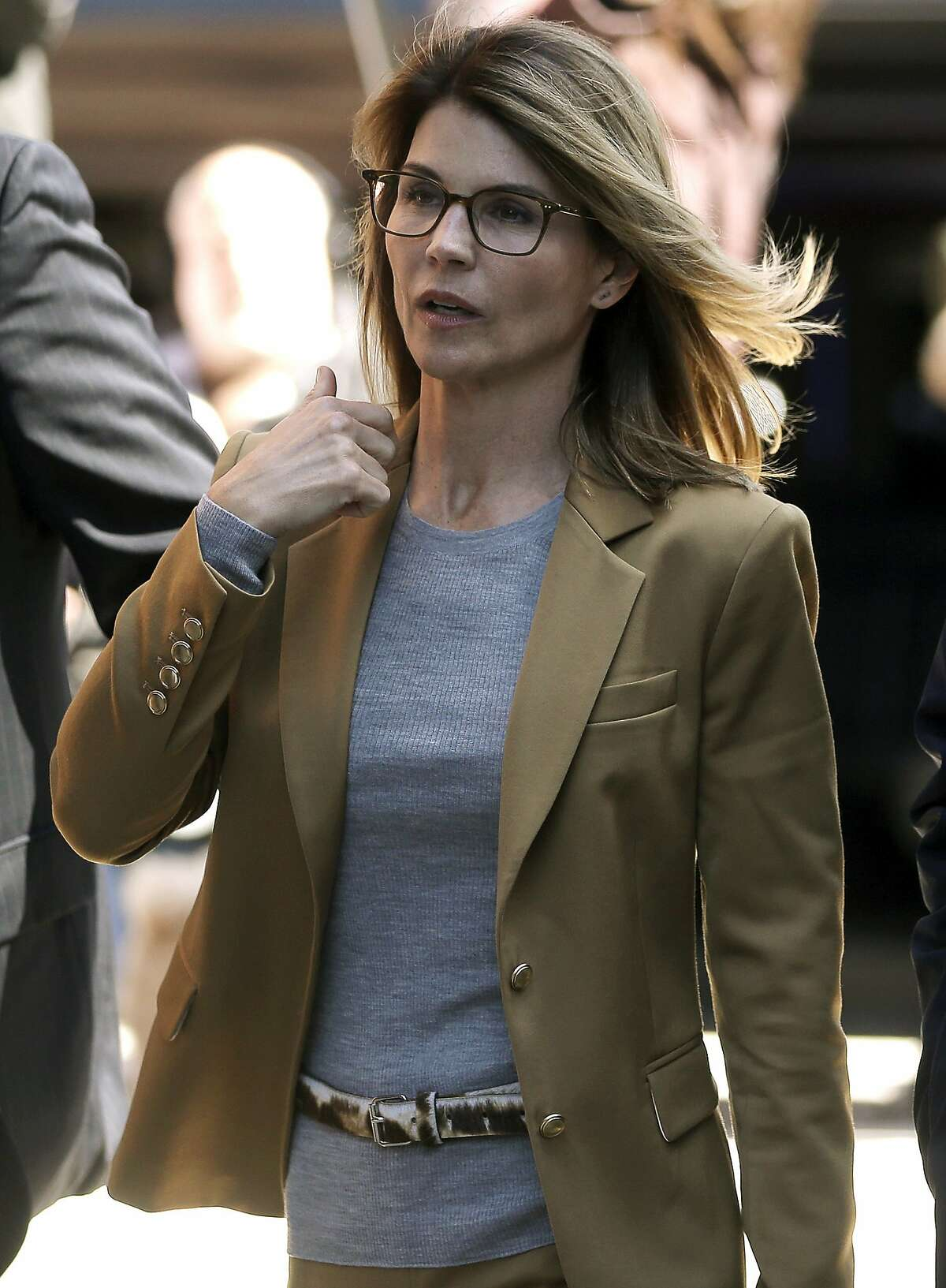 FILE -- Actress Lori Loughlin arrives at federal court in Boston on Wednesday, April 3, 2019, to face charges in a nationwide college admissions bribery scandal.