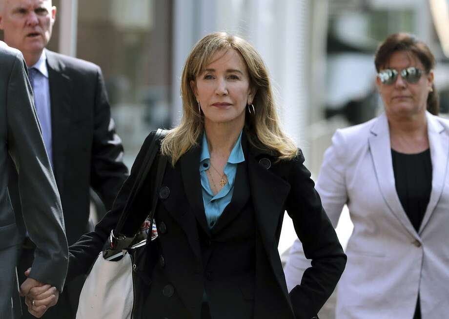 Actress Felicity Huffman arrives at federal court in Boston on April 3 to face charges in a college admissions bribery prosecution. The Justice Department charged 50 people in the case. Photo: Charles Krupa / Associated Press