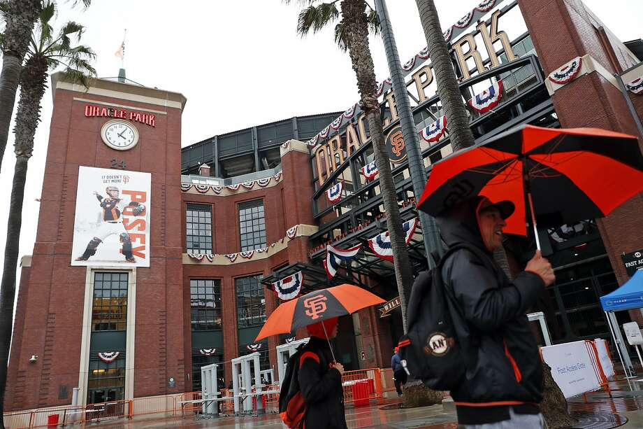 Rain falls outside Oracle Park before San Francisco Giants play the Oakland Athletics in San Francisco, Calif., on Monday, March 25, 2019. Photo: Scott Strazzante / The Chronicle
