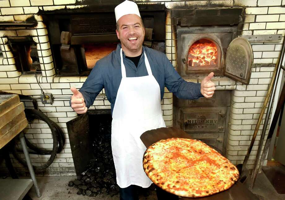 "New Haven, Connecticut - November 19, 2018: Colin M. Caplan, author of ""Pizza in New Haven"", stands by the 1938 coal-fired pizza take-out oven at Pepe's Pizza restaurant on Wooster Street in New Haven. Photo: Peter Hvizdak / Hearst Connecticut Media / New Haven Register"