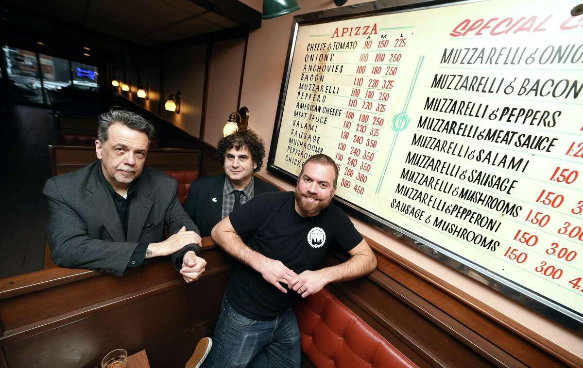 Left to right, Gorman Bechard, Dean Falcone and Colin Caplan at Modern Pizza in New Haven, in 2018. Caplan, author of the book Pizza in New Haven and contributor to Taste of New Haven, has started a petition to bring awareness to the bill.