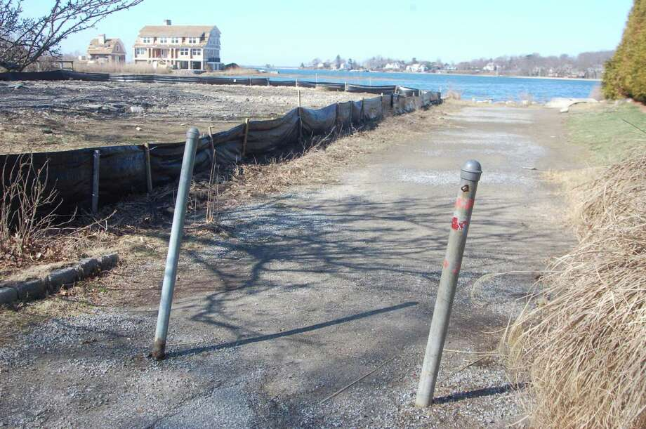 Neighbors are concerned that a planned new house for the now vacant lot at 17 Bryon Road in Old Greenwich will cut off access they have enjoyed for close to 100 years to Greenwich Cove. The matter is now before the town's Planning and Zoning Commission over the question of whether the path leading to the water is a private road in the town or not. Photo: Ken Borsuk / Hearst Connecticut Media