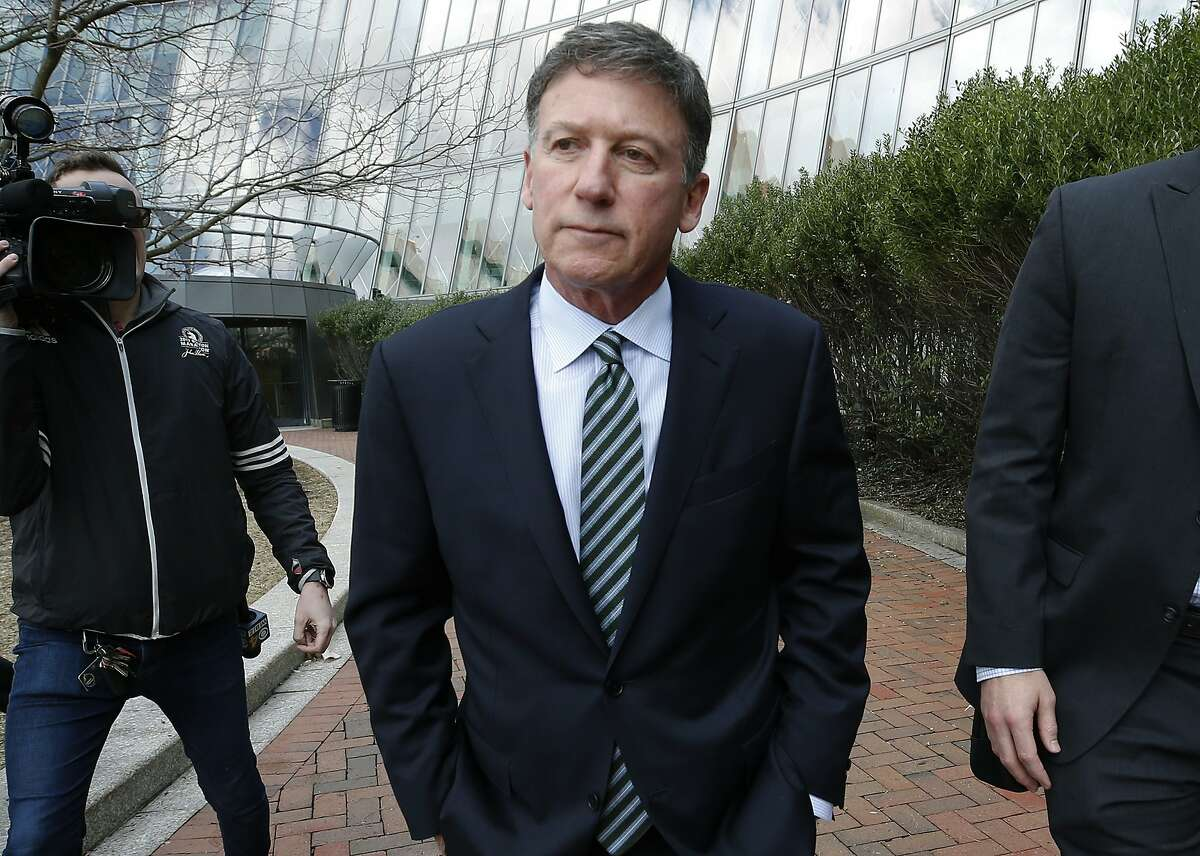 Bruce Isackson departs federal court in Boston on Wednesday, April 3, 2019, after facing charges in a nationwide college admissions bribery scandal. (AP Photos/Michael Dwyer)