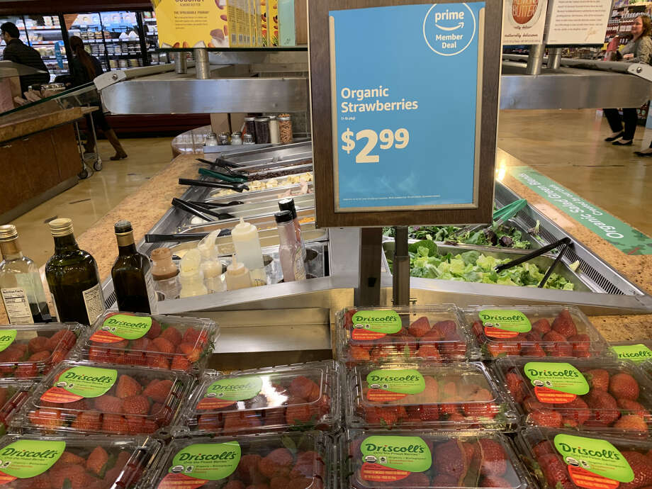 Whole Foods is introducing new weekly deals exclusively for Prime members. One of these is organic strawberries for $2.99/lb, saving Prime members $2. Photo: Madeline Wells