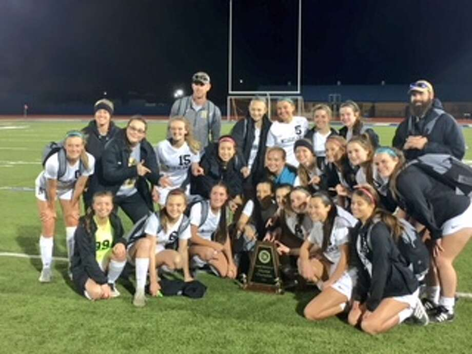 The Nederland girls soccer team poses for a picture following a 3-0 win over Manvel in the area round of the UIL Class 5A state playoffs on Tuesday night at Barbers Hill High School. Photo By Matt Faye/The Enterprise. Photo: Matt Faye