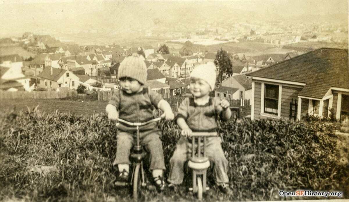 Two adorable little ones pose on a hillside in San Francisco. But where?