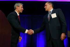 San Antonio Mayor Ron Nirenberg, left, and City Council District 6 member Greg Brockhouse shake hands at the end of a mayoral debate hosted by Visit San Antonio at the Wyndham Riverwalk on April 3. Early voting begins Monday, April 22, and continues through Tuesday, April 30. Polls are closed Friday for the San Jacinto holiday and on Sunday, April 28.