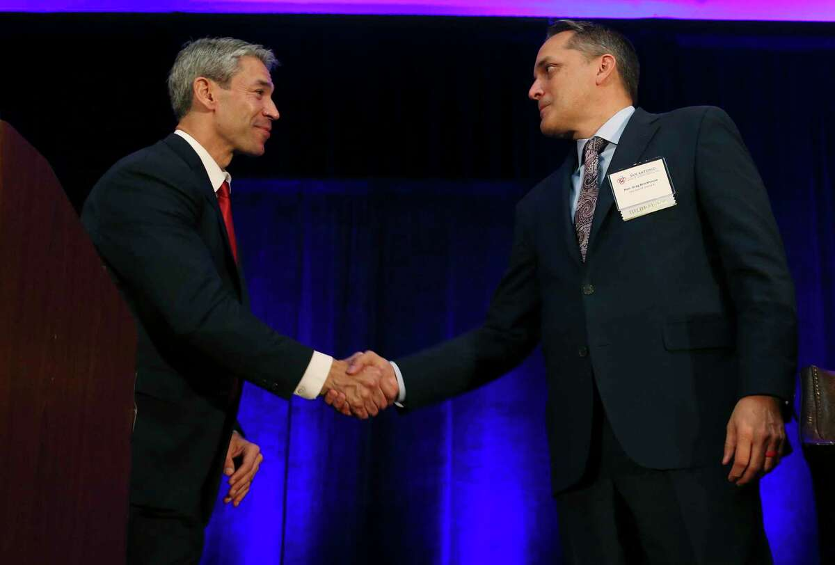 San Antonio Mayor Ron Nirenberg, left, and City Council District 6 member Greg Brockhouse shake hands at the end of a mayoral debate at the Wyndham Riverwalk on April 3, 2019. Nirenberg defeated Brockhouse in a runoff that year for a second term; there will be a rematch between the two men in the May 1 city elections.