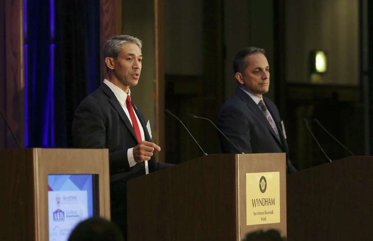 San Antonio Mayor Ron Nirenberg, left, answers a question during a mayoral debate with City Council District 6 Member Greg Brockhouse, right, hosted by Visit San Antonio at the Wyndham Riverwalk, Wednesday, April 3, 2019.
