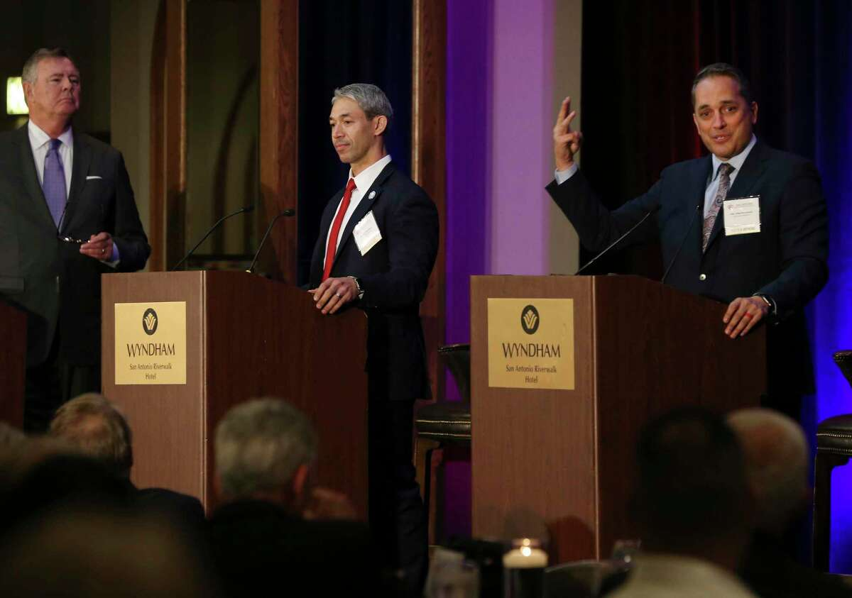 Then-Councilman Greg Brockhouse, right, answers a question during a mayoral debate with San Antonio Mayor Ron Nirenberg, center, at the Wyndham Riverwalk on April 3, 2019. At left is David Dunham, vice president of development for Texas Monthly. He was moderating the debate.