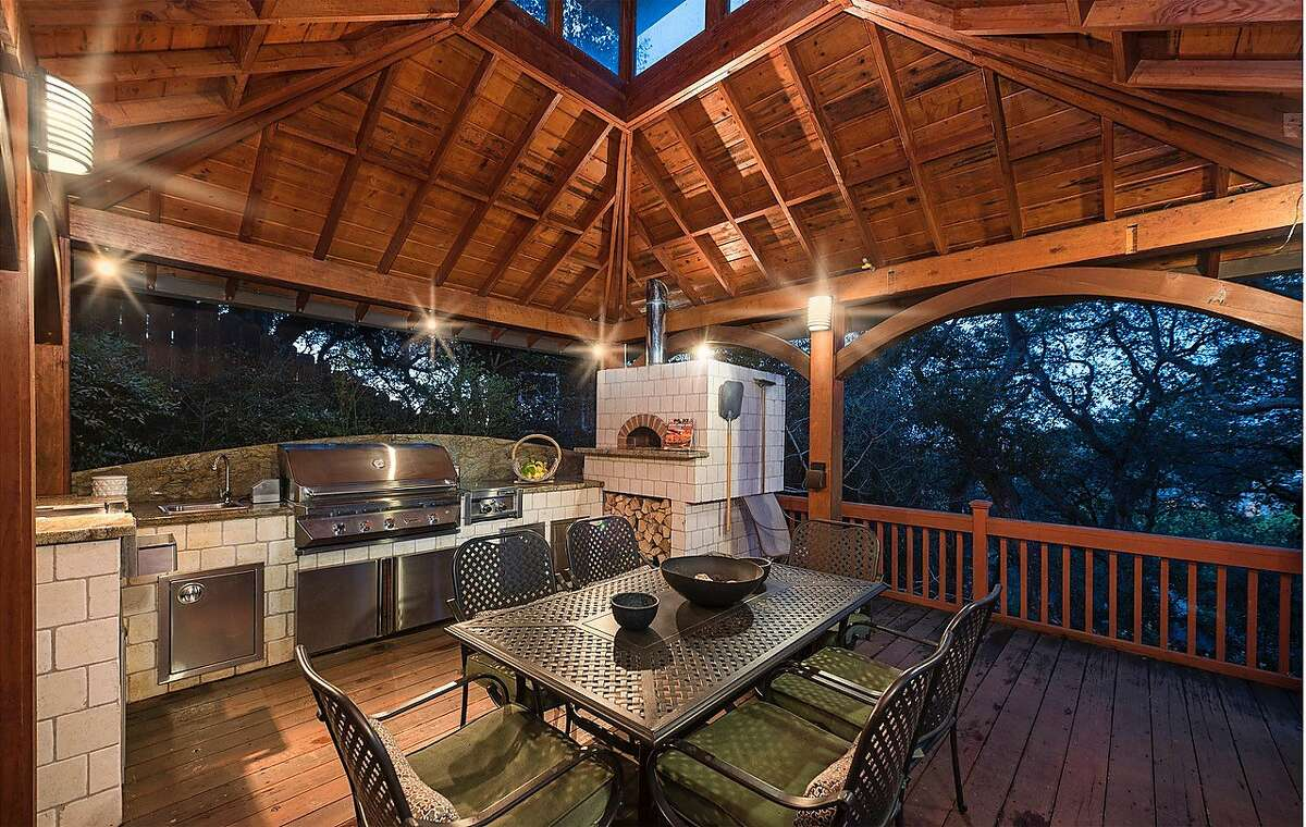 Homes with outdoor kitchens and pizza ovens tend to sell for higher-than-expected prices, according to a Zillow study. This home at 10 Shratton Ave. in San Carlos, on the market in April 2019 for $2,499,000, has both.