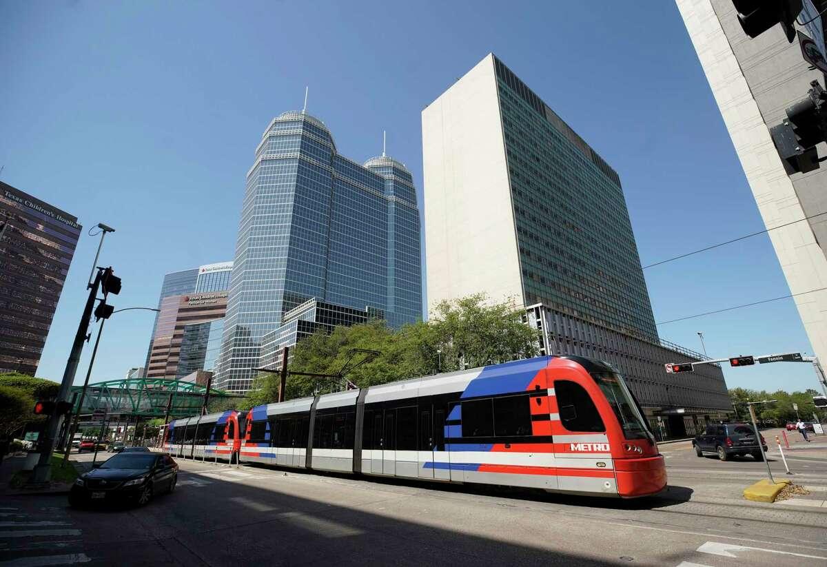 A Metro light rail train is shown in the Medical Center along Fannin in Houston.